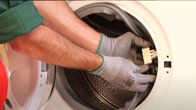 Comment tester la sécurité de porte d'un lave-linge ?